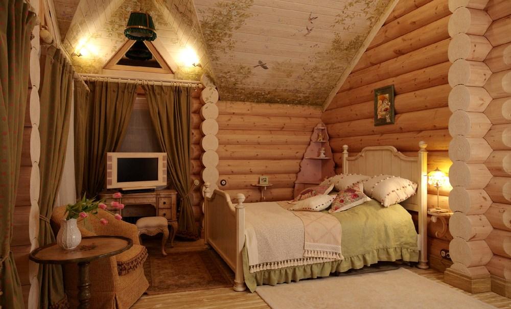 Интерьер спальни в деревянном доме2